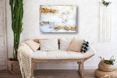 Beautiful spring decorated interior in white textured colors. Living room, beige sofa with a rug and a large cactus.